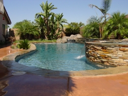 Remodel 1 final-  Natural pool design with raised wall, sheer descent and rock waterfall
