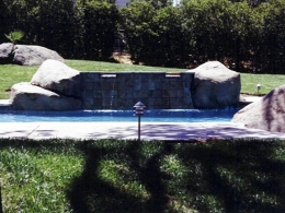 Completed pool and spa renovation with added rock work and tile spillways