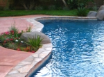 Completed-remodel-with-added-spa-waterfall-and-raised-ledgerstone-pool-wall