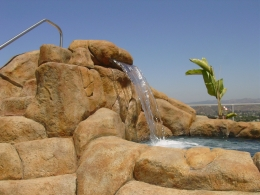 Carved rock water feature with sheer descent and slide