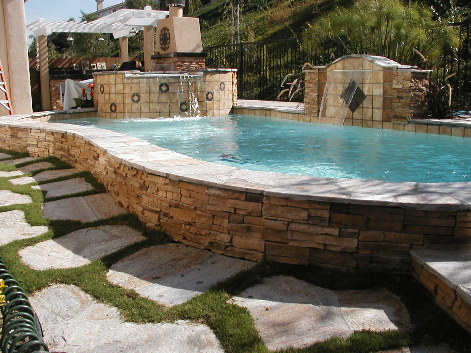how to build swimming pool water feature