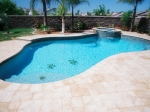 free-form-pool-with-paver-decking-raised-spa-with-spillover-and-tile-mosaic_0