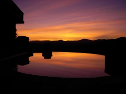 Vanishing edge pool reflecting a summer sunrise