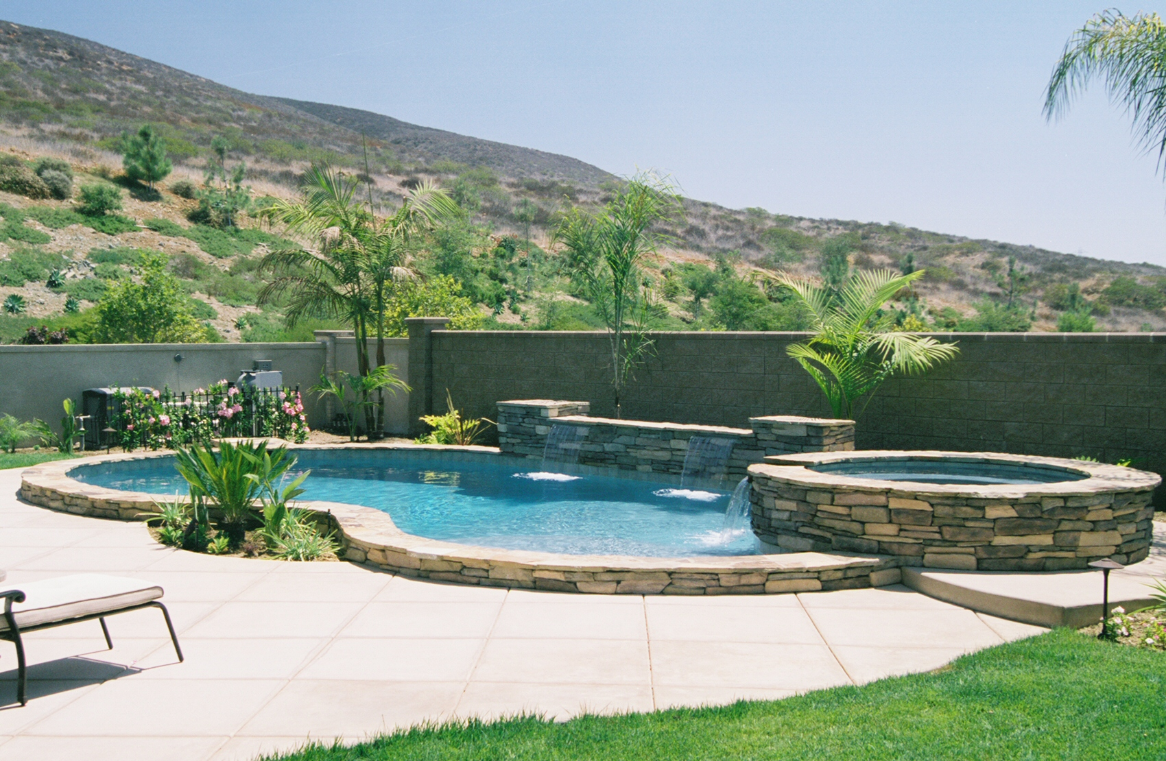 Free Form Raised Pool With Ledgerstone Quartzite Coping Spa Sheer Descent Waterfalls